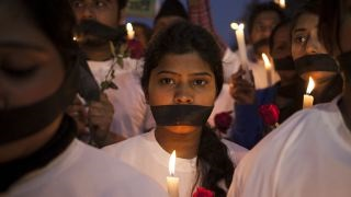 "Indian women participate in a candle light vigil for ""India's Daughter."""