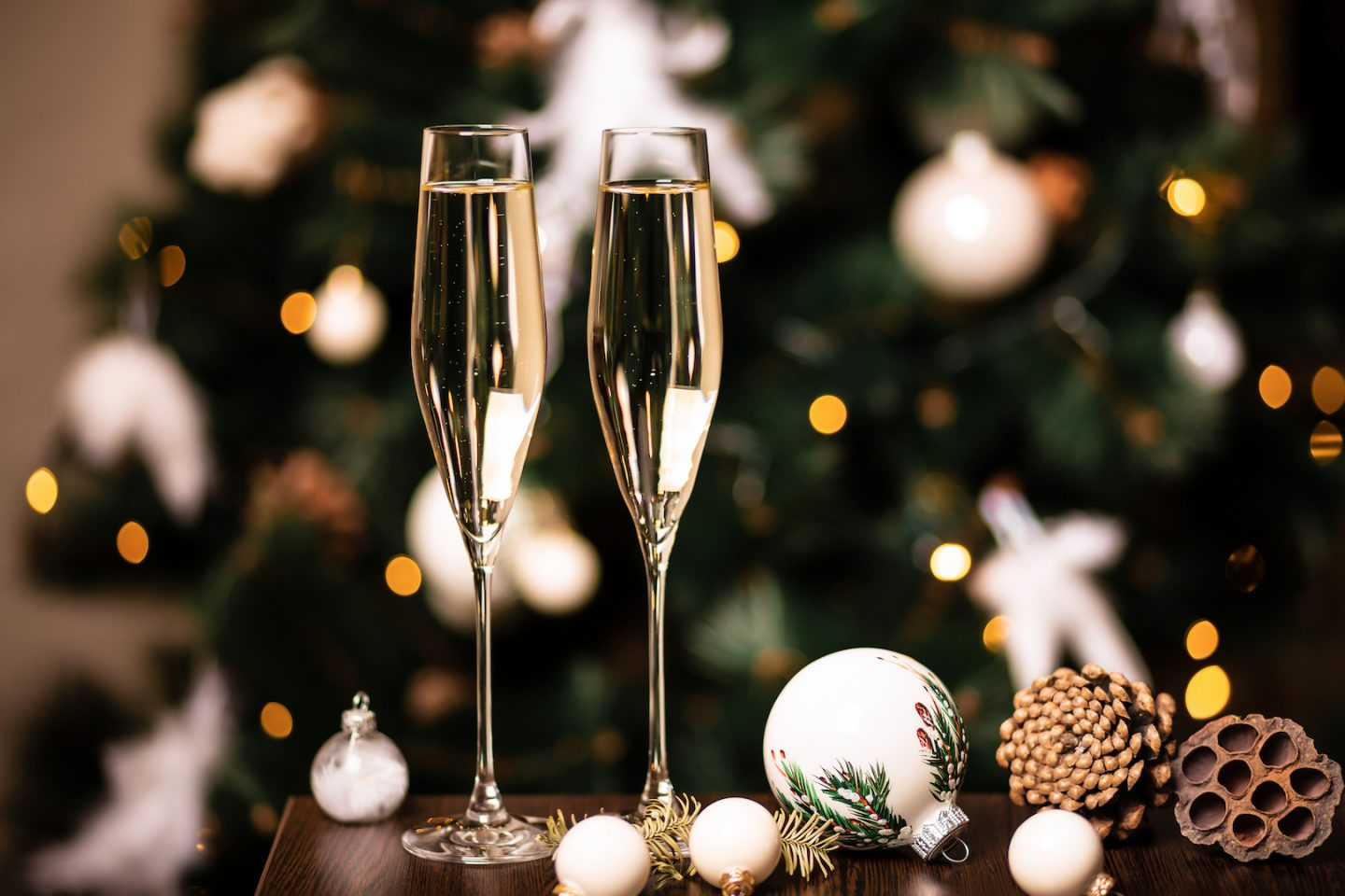 New Year Champagne Christmas Composition With Champagne In Interior And White Christmas Tree Decorations Bokeh Garland Lights And Holiday Atmosphere Hashtag Life